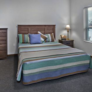 Residents Bedroom at Riverview Landing